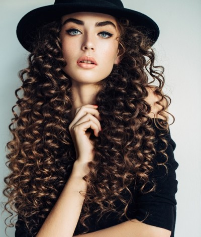 Beautiful girl with make-up and hat
