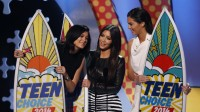 "Kylie Jenner, Kim Kardashian and Kendall Jenner accept the choice reality show award for ""Keeping Up with the Kardashians"" during the Teen Choice Awards 2014 in Los Angeles"