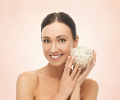 picture of beautiful woman with salt ball for bathing